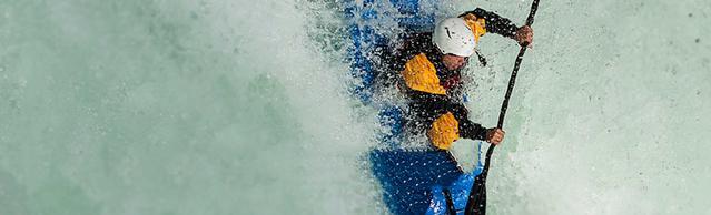 man kayaking on rough water