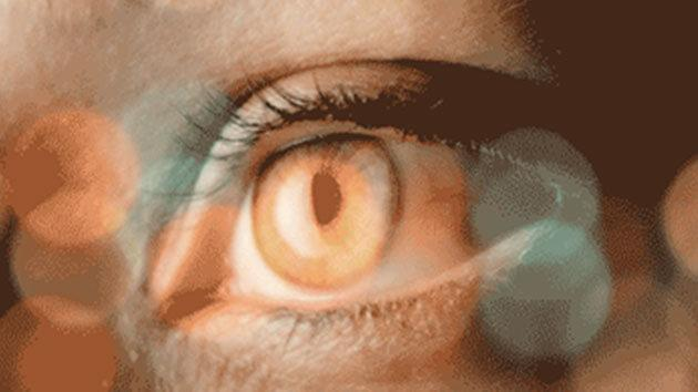 close up of an eye with bokeh (colored circles of light)