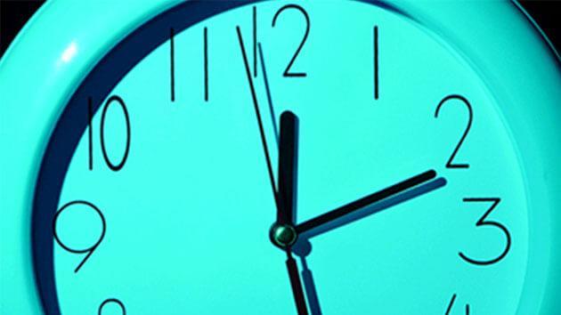 tight shot of a teal clock