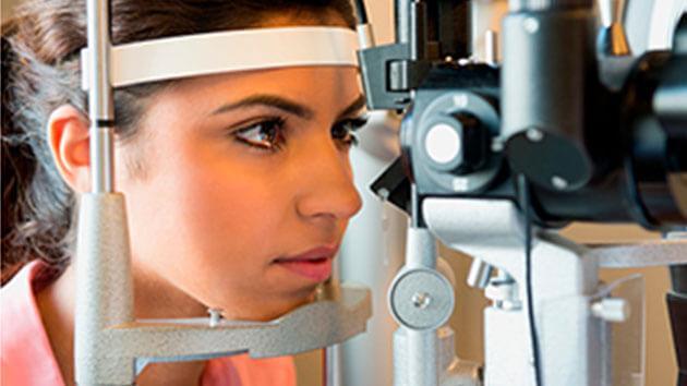 young girl receiving eye exam (side shot)